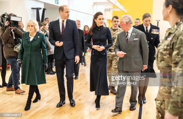 Britain's Prince William Duke of Cambridge and his wife Britain's Catherine Duchess of Cambridge talk with his father Britain's Prince Charles Prince...