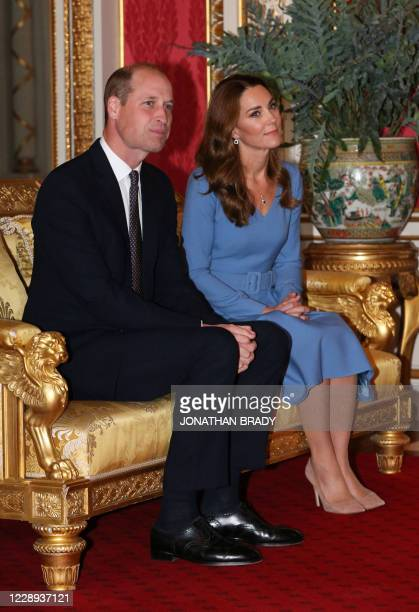 Britain's Prince William, Duke of Cambridge and his wife Britain's Catherine, Duchess of Cambridge talk with Ukraine's President Volodymyr...