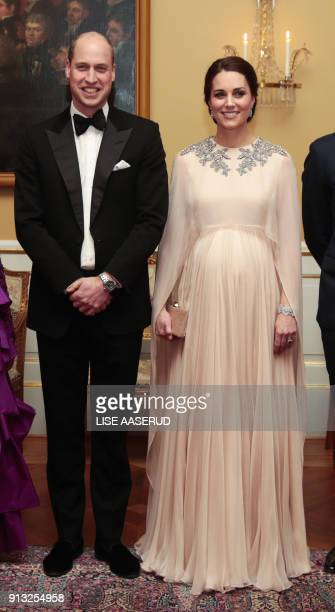 Britain's Prince William Duke of Cambridge and his wife Britain's Catherine Duchess of Cambridge pose for photographs on February 1 before the...
