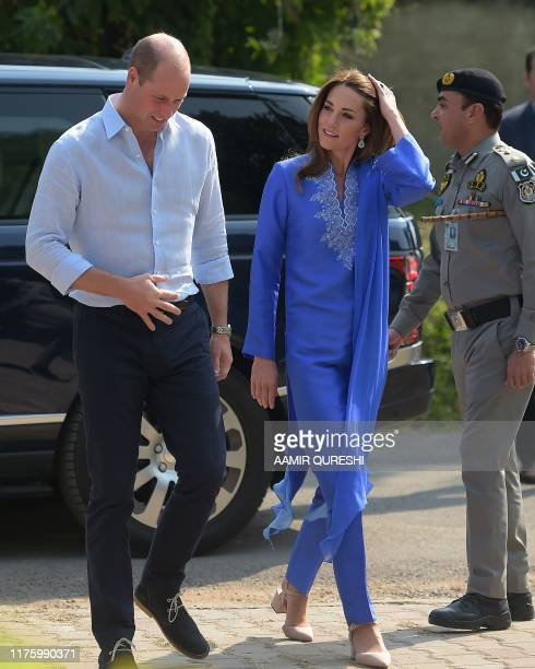 Britain's Prince William , Duke of Cambridge, and his wife Catherine , Duchess of Cambridge, arrive during their visit to a government-run school in...