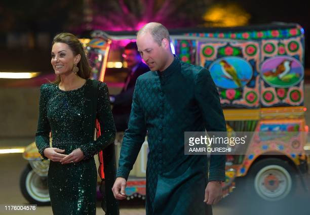 Britain's Prince William Duke of Cambridge and his wife Catherine Duchess of Cambridge arrive at decorated autorickshaw to attend a reception in...