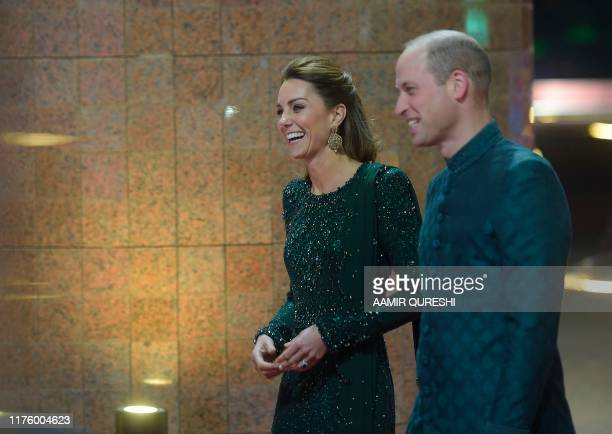 Britain's Prince William Duke of Cambridge and his wife Catherine Duchess of Cambridge arrive to attend a reception in Islamabad on October 15 2019...