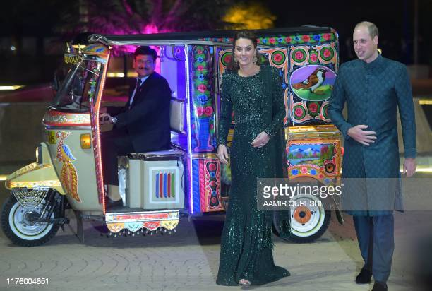 Britain's Prince William Duke of Cambridge and his wife Catherine Duchess of Cambridge arrive on a decorated autorickshaw to attend a reception in...