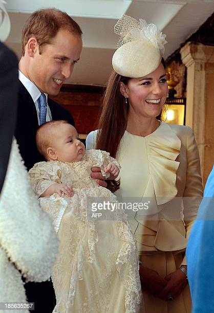Britain's Prince William Duke of Cambridge and his wife Catherine Duchess of Cambridge arrive with their son Prince George of Cambridge at Chapel...