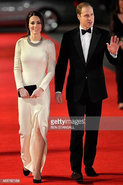 Britain's Prince William Duke of Cambridge and his wife Catherine Duchess of Cambridge arrive to attend the royal film premier of Mandela Long Walk...