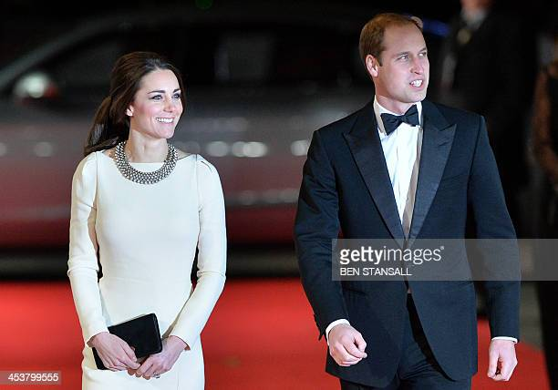 """Britain's Prince William, Duke of Cambridge, and his wife Catherine, Duchess of Cambridge, arrive to attend the royal film premier of """"Mandela: Long..."""