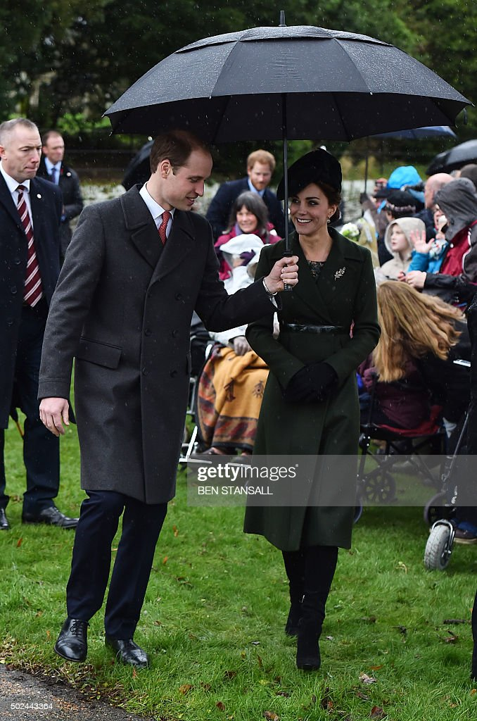 Britain's Prince William (L), Duke of Cambridge and his wife Catherine, Duchess of Cambridge attend a traditional Christmas Day Church Service at Sandringham in eastern England, on December 25, 2015. STANSALL