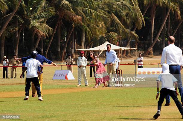 Britain's Prince William Duke of Cambridge and his wife Catherine Duchess of Cambridge play cricket at Oval Maidan recreational ground in Mumbai...