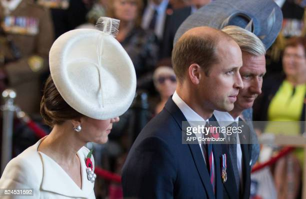 Britain's Prince William Duke of Cambridge and his wife Catherine Duchess of Cambridge walks along side King Philippe of Belgium as they attend the...