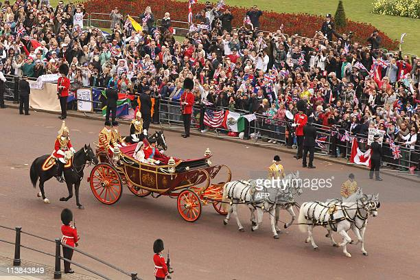 Britain's Prince William Duke of Cambridge and his wife Kate Duchess of Cambridge approach Buckingham Palace by carriage procession following their...