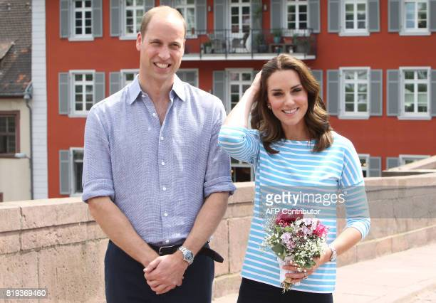 Britain's Prince William, Duke of Cambridge and his wife Kate, Duchess of Cambridge pose for a picture on the Old Bridge in the historic center of...