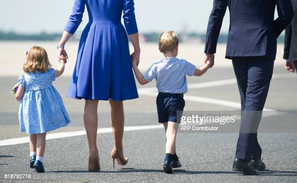 Britain's Prince William Duke of Cambridge and his wife Kate the Duchess of Cambridge and their children Prince George and Princess Charlotte arrive...