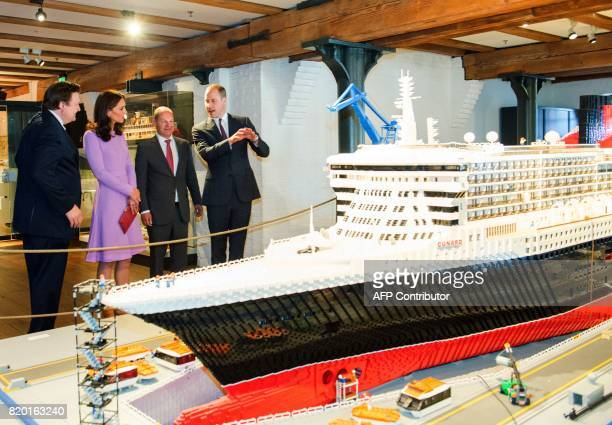 Britain's Prince William Duke of Cambridge and his wife Kate the Duchess of Cambridge stand with Hamburg Mayor Olf Scholz and museum director Peter...