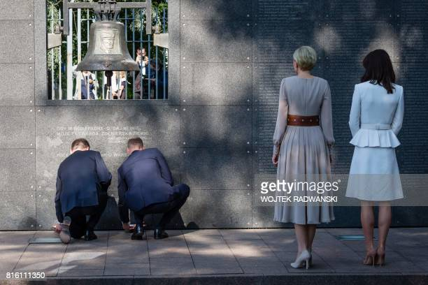Britain's Prince William Duke of Cambridge and Polish President Andrzej Duda light candles as their wifes Britain's Catherine Duchess of Cambridge...