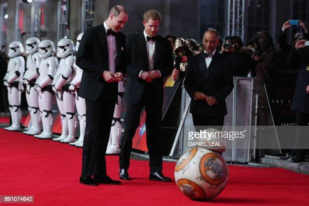 Britain's Prince William Duke of Cambridge and Prince Harry are greeted by droid BB8 as they arrive for the European Premiere of Star Wars The Last...