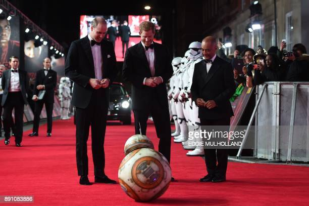 TOPSHOT Britain's Prince William Duke of Cambridge and Prince Harry are greeted by droid BB8 as they arrive for the European Premiere of Star Wars...