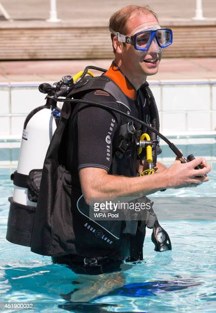 Britain's Prince William Duke of Cambridge as he scuba dives with British SubAqua Club members at a swimming pool on July 9 2014 in London England In...