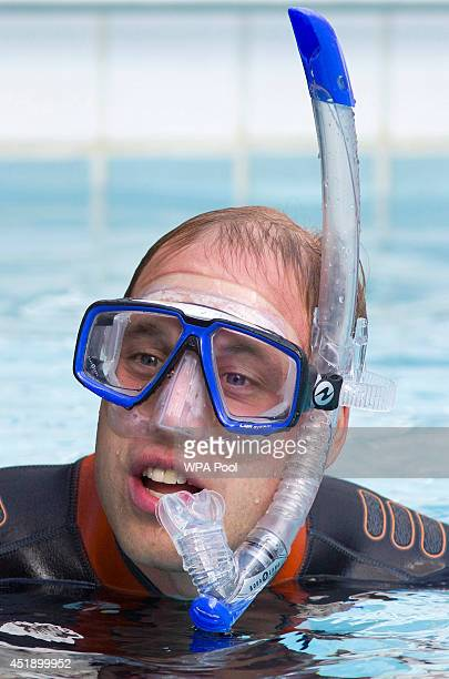 Britain's Prince William Duke of Cambridge as he snorkels with British SubAqua Club members at a swimming pool on July 9 2014 in London England In...