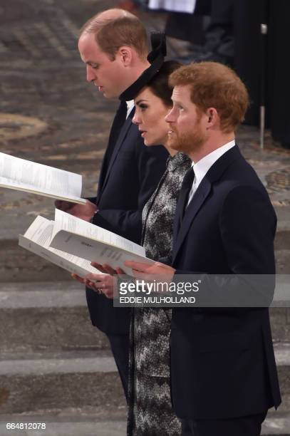 Britain's Prince William, Duke of Cambridge, Britain's Catherine, Duchess of Cambridge and Britain's Prince Harry attend a Service of Remembrance at...