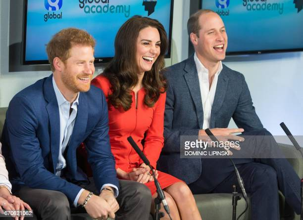 Britain's Prince William Duke of Cambridge Britain's Catherine Duchess of Cambridge and Britain's Prince Harry tour a TV studio during the official...
