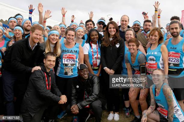 Britain's Prince William Duke of Cambridge Britain's Catherine Duchess of Cambridge and Britain's Prince Harry pose with runners representing their...