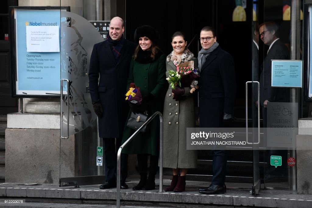Britain's Prince William, Duke of Cambridge, Britain's Catherine, Duchess of Cambridge, Sweden's Crown Princess Victoria and Prince Daniel pose for a photo at the entrance to the Nobel Museum in Stockholm on January 30, 2018. The Duke and Duchess of Cambridge are on a 4-day visit to Sweden and Norway. / AFP PHOTO / Jonathan NACKSTRAND