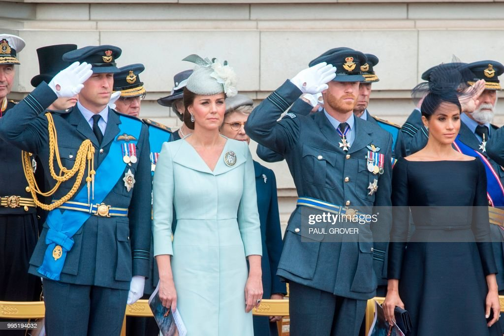 Britain's Prince William, Duke of Cambridge, Britain's Catherine, Duchess of Cambridge, Britain's Prince Harry, Duke of Sussex, and Britain's Meghan, Duchess of Sussex attend a ceremony to present a new Queen's Colour to the Royal Air Force (RAF) at Buckingham Palace in London on July 10, 2018 to mark its centenary. - The Queen and members of the royal family took part a series of engagements on July 10 to mark the centenary of the Royal Air Force.