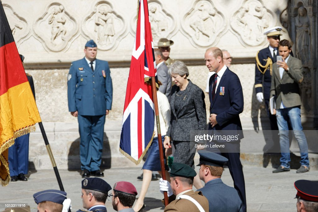 Britain's Prince William, Duke of Cambridge, Britain's Prime Minister Theresa May, and French Minister of the Armed Forces, Florence Parly, leave after a religious ceremony to mark the 100th anniversary of the World War I (WW1) Battle of Amiens, at the Cathedral on August 8, 2018 in Amiens, France.