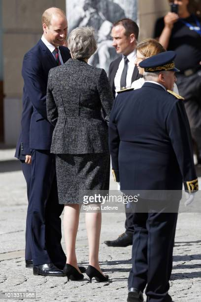 Britain's Prince William Duke of Cambridge Britain's Prime Minister Theresa May leave after a religious ceremony to mark the 100th anniversary of the...