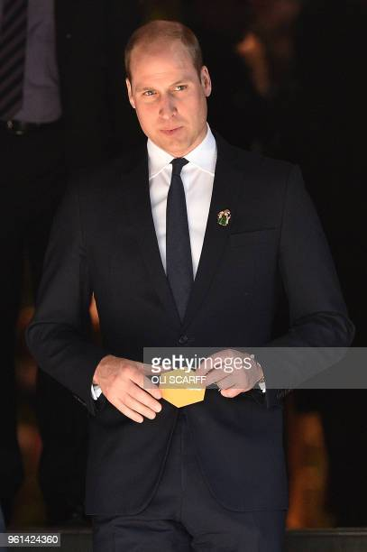 Britain's Prince William Duke of Cambridge carries his message to hang on a 'tree of hope' as he leaves after attending The Manchester Arena National...