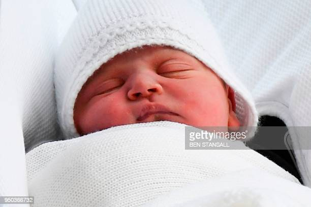 TOPSHOT Britain's Prince William Duke of Cambridge carries his newlyborn son from the Lindo Wing at St Mary's Hospital in central London on April 23...