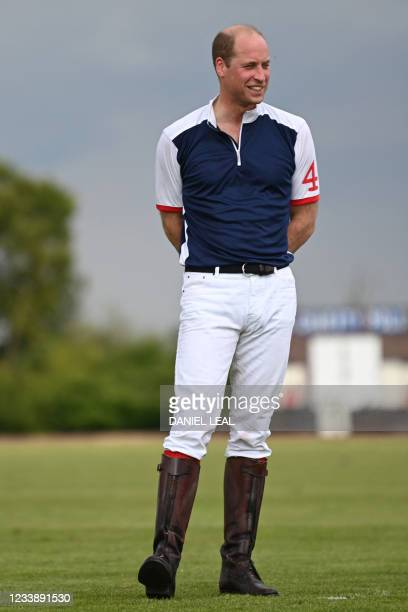 Britain's Prince William, Duke of Cambridge gestures after the Royal Charity Polo Cup 2021 match at the Guards Polo Club in Windsor, Berkshire on...