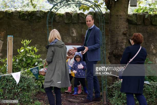 Britain's Prince William, Duke of Cambridge gestures during a visit to Starbank Park to hear about the work of Fields in Trust, along with Britain's...