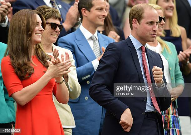 Britain's Prince William Duke of Cambridge gestures next to his wife Catherine Duchess of Cambridge as he watches a member of the crowd catch Andy...
