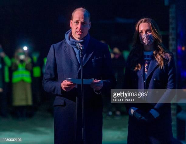 Britain's Prince William , Duke of Cambridge gives a speech alongside Britain's Catherine , Duchess of Cambridge after meeting staff at a food bank...
