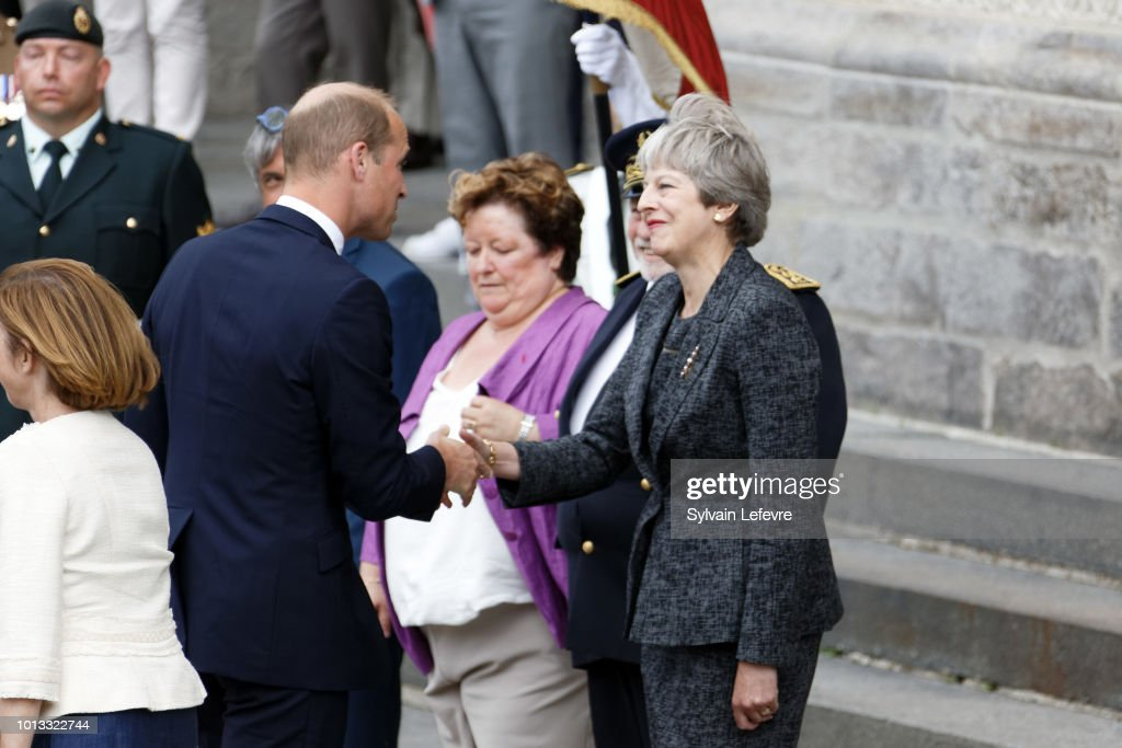 Britain's Prince William, Duke of Cambridge, greets Britain's Prime Minister Theresa May after a religious ceremony to mark the 100th anniversary of the World War I (WW1) Battle of Amiens, at the Cathedral on August 8, 2018 in Amiens, France.