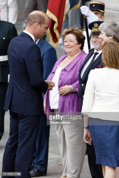 Britain's Prince William Duke of Cambridge greets Britain's Prime Minister Theresa May after a religious ceremony to mark the 100th anniversary of...