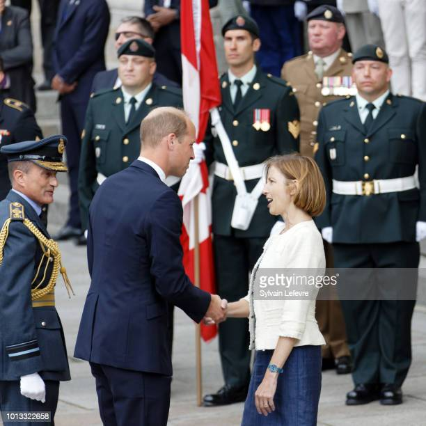 Britain's Prince William Duke of Cambridge greets French Minister of the Armed Forces Florence Parly as Britain's Prime Minister Theresa May watches...