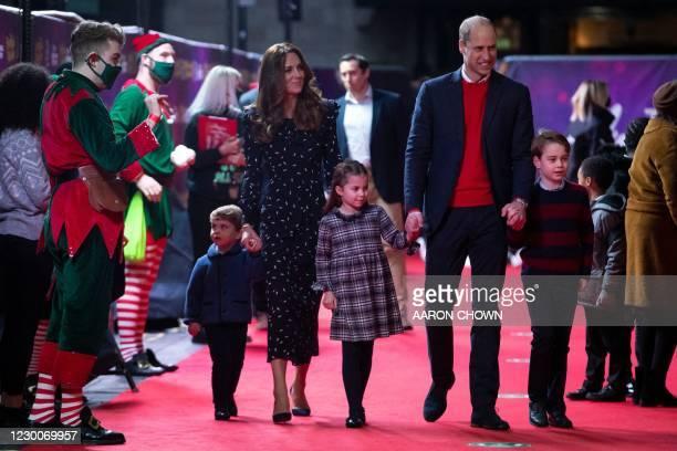 Britain's Prince William, Duke of Cambridge, his wife Britain's Catherine, Duchess of Cambridge, and their children Britain's Prince George of...