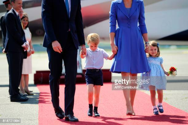 Britain's Prince William Duke of Cambridge his wife Kate the Duchess of Cambridge and their children Prince George and Princess Charlotte arrive at...