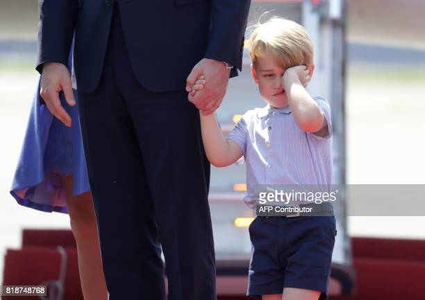 Britain's Prince William, Duke of Cambridge , his wife Kate, the Duchess of Cambridge with their children Prince George and Princess Charlotte arrive...