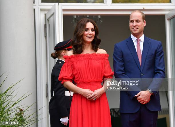 Britain's Prince William Duke of Cambridge his wife Kate the Duchess of Cambridge attend the Queen's Birthday Garden Party at the Ambassador's...