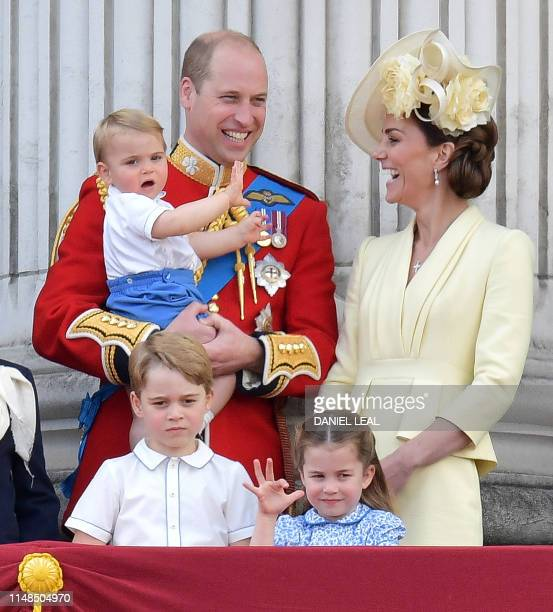 Britain's Prince William Duke of Cambridge holding Prince Louis Prince George Princess Charlotte and Britain's Catherine Duchess of Cambridge stand...