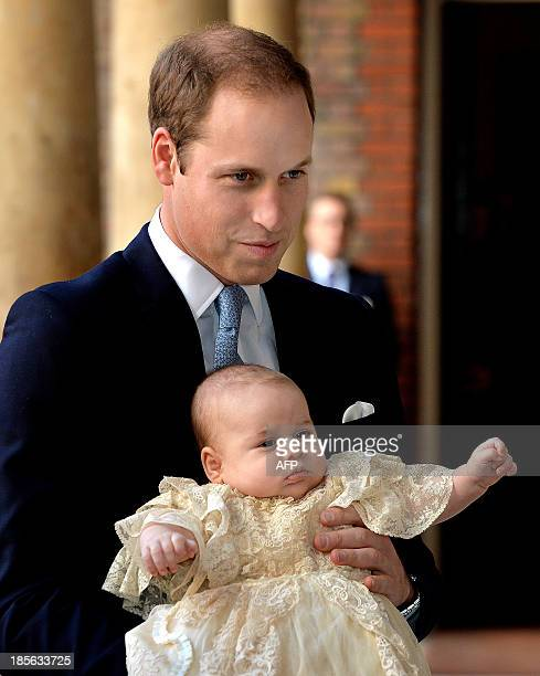 Britain's Prince William, Duke of Cambridge holds his son, Prince George of Cambridge, as he arrives at Chapel Royal in St James's Palace in central...