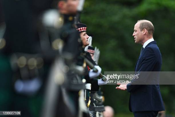 Britain's Prince William, Duke of Cambridge inspects the Guard of Honour on the forecourt of the Palace of Holyroodhouse in Edinburgh, Scotland on...