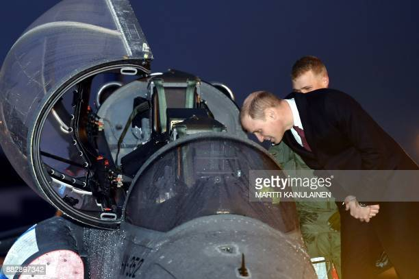 Britain's Prince William Duke of Cambridge is presented a British singleengined twoseat advanced jet trainer of the Finnish Air Force at the Helsinki...
