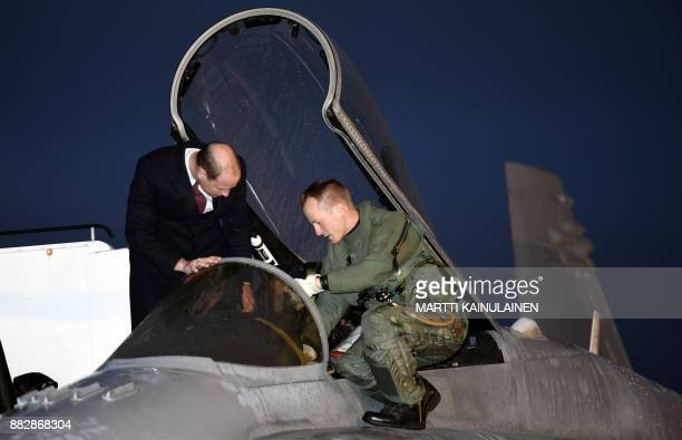 Britain's Prince William Duke of Cambridge is presented a Finnish Air Force's Boeing F/A18 Hornet multirole fighter at the Helsinki International...