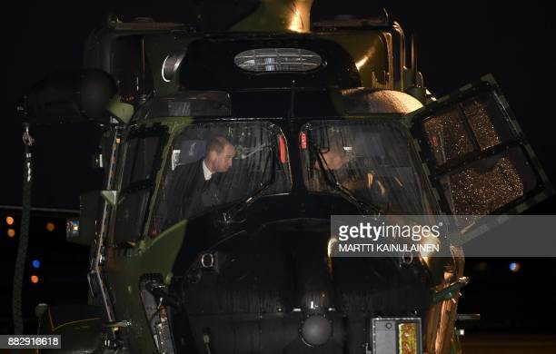 Britain's Prince William Duke of Cambridge is presented a NH90 helicopter of the Finnish Army at the Helsinki International Airport in Vantaa Finland...