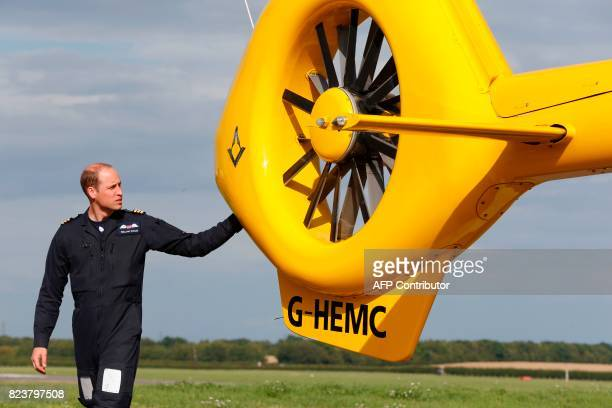 Britain's Prince William Duke of Cambridge is seen as he starts his final shift working with the East Anglian Air Ambulance as a pilot at Cambridge...