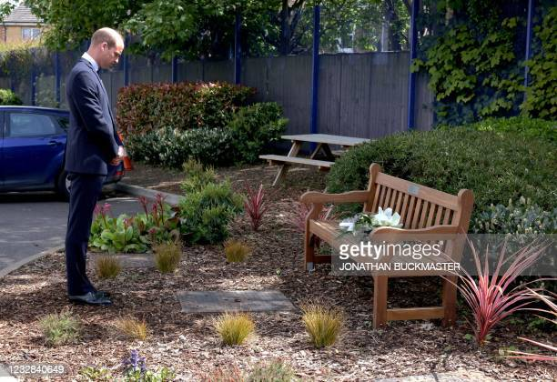 Britain's Prince William, Duke of Cambridge lays a floral wreath on a bench dedicated to Sergeant Matt Ratana, during his visit to Croydon Custody...